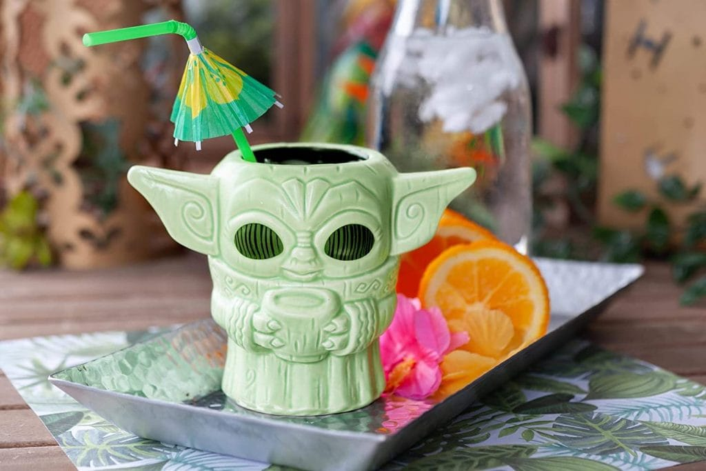 green tiki mug baby Yoda meme looking smug holding a cup