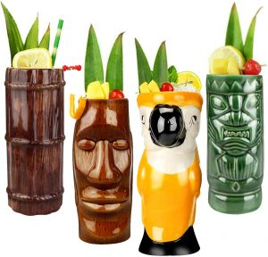 set of four colorful tall tiki mugs