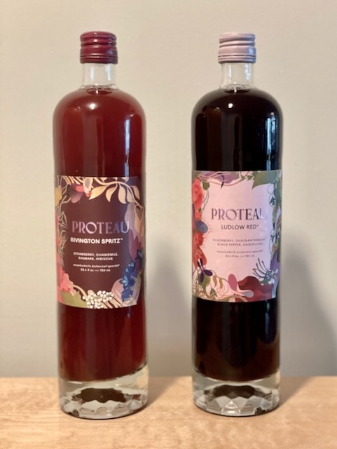 proteau front of bottles