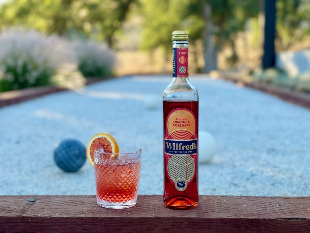 Wilfreds aperitif next to a non alcoholic spritz on a bocce court
